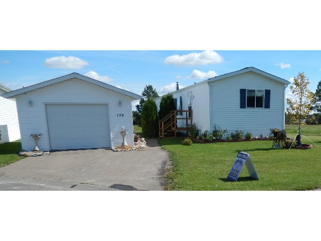 SOLD!  Just like new!  This 2 bedr, 2 bath home backs onto a field & no neighbor on one side...private cul de sac...vaulted ceilings, skylight....recent upgrades incl. HWT (1 yr), washer/dryer (1 yr), planters & landscaping, shingles (2008).  Single garage measures 16x24 ft. Also has a shed.  Front faces west, back faces east.  Smoke free & pet free home.  Monthly Lot rent is $350
